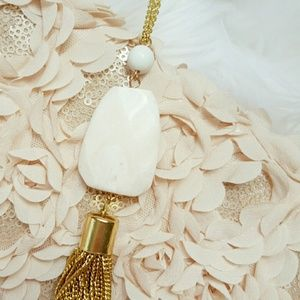 Jewelry - While pendant necklace with gold fringe