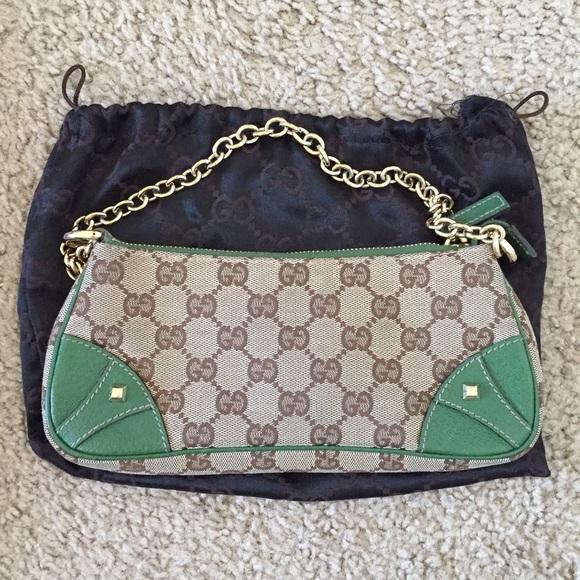 0a3e70a6b3c9 Gucci Handbags - Authentic Gucci mini chain clutch bag