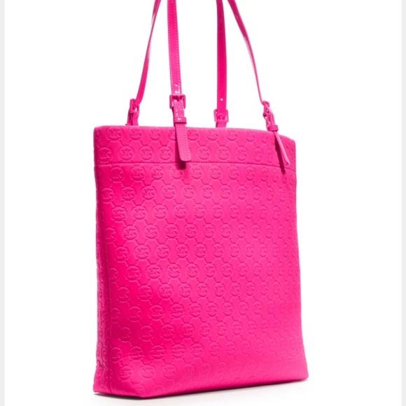 c42afa0085 Michael Kors hot pink neoprene tote. M 56ed71a056b2d6ba98003615