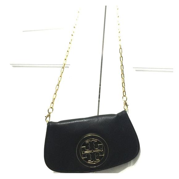 a86952fca51 Tory Burch Logo Flap Crossbody Bag. M 56ed9344f739bcd7310073bf