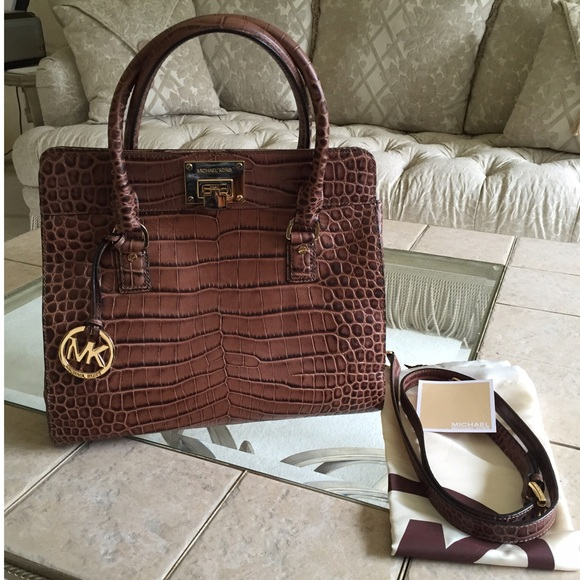 cf1e21159128 Authentic Michael Kors Astrid handbag. M_56edc5e17fab3a4ac903ff2f