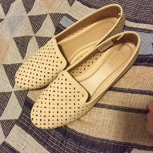 Perforated cream slip-ons