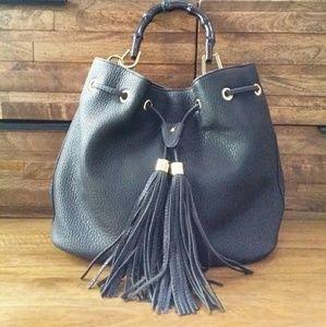Black bucket handbag with tassel
