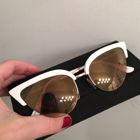 d729b20ee93 White rimmed cat eye sunglasses. M 56f091125c12f8ed04003ce5