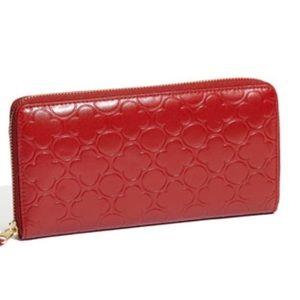 Comme des Garçons Embossed Leather Wallet
