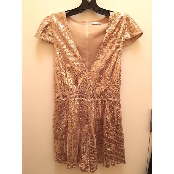 2a04fc86ef99 Charlotte Russe Dresses   Skirts - Charlotte Russe Animal Print Gold Sequin  Romper