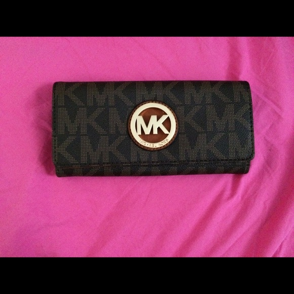 5f7daf8ca21d MK Fulton Brown Logo Gold Carryall Wallet
