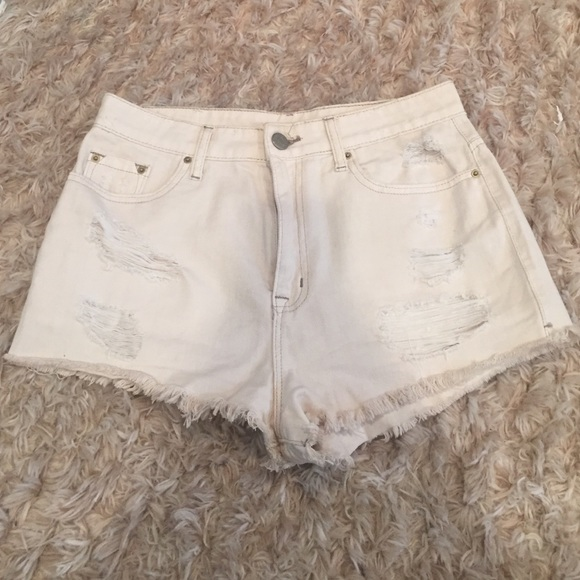 56% off Urban Outfitters Pants - CREAM RIPPED JEAN SHORTS‼ from ...