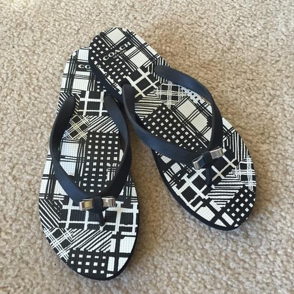 005cc574f6c4f2 Coach Shoes - Coach black white flip flops with silver bow