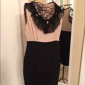 Nude/black dress with delicate black ruffle.