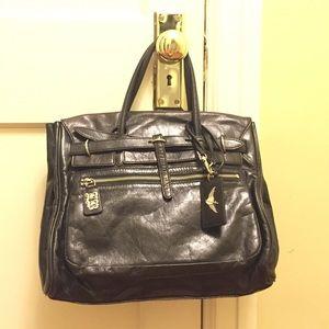 Black leather hand purse