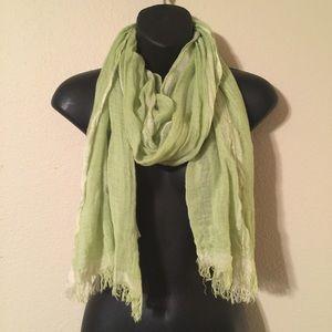 Bright light green scarf.