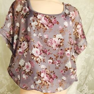 Lavender crop top with flowers.