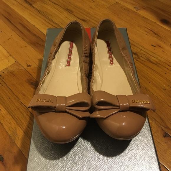 f318092614 Prada patent leather nude bow ballet flats. M_56f4a6c341b4e04a330161f0