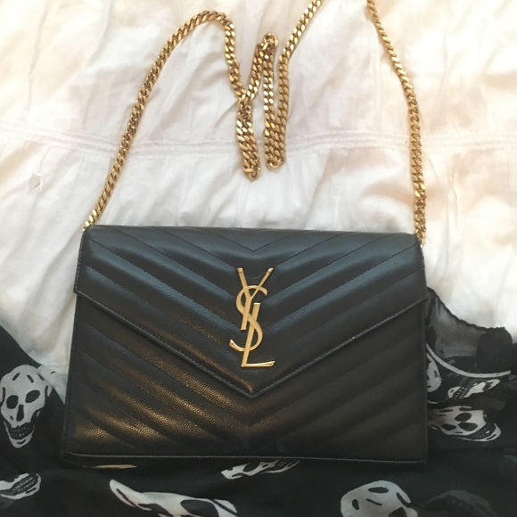 76da81b051fd YSL clutch with gold chain. M 56f6c5066d64bc908c05e0b9
