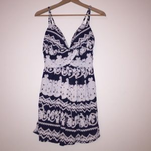 Navy blue and white patterned romper