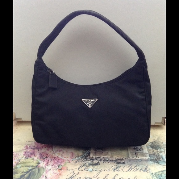 86ce94c717d1 Prada Tessuto Nylon Mini. M_56fab18c7f0a050fe901ac6e. Other Bags ...