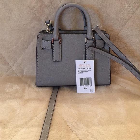 25caa278b38d ... Michael Kors Bags - Michael kors Dillon stripe mini top zip crossbody  ...