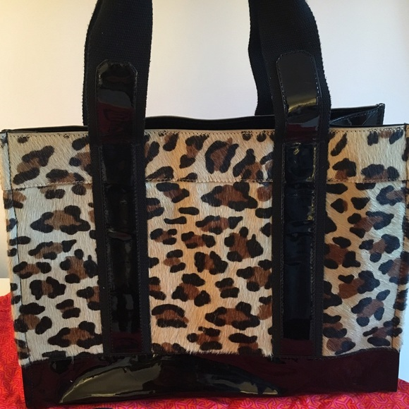 03b6034aeba8 Tory Burch Pony Hair Leopard Tote Bag. Tory Burch.  M_56fb1c8b4127d08d85011275. M_56fb1c8e8f0fc458b0010fc9.  M_56fb1c90f0137d3b0b026bb9
