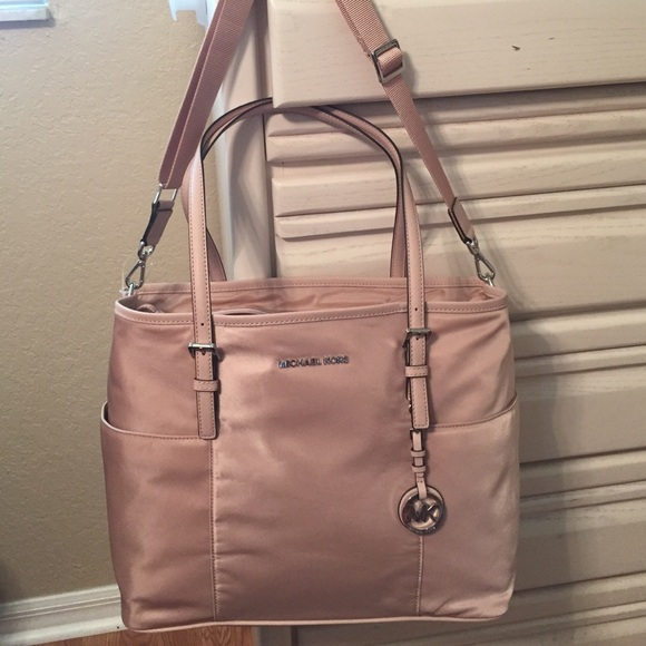 21 off michael michael kors handbags michael kors baby diaper bag in pink nylon nwt from. Black Bedroom Furniture Sets. Home Design Ideas