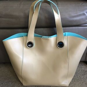 Tan color handbag. Brand new