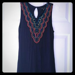 Adorable summer dress. Navy with coral detail
