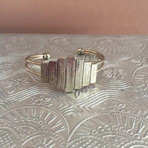 Gold tone mod cuff bracelet