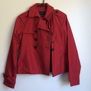 Red double-breasted Banana Republic trench coat.