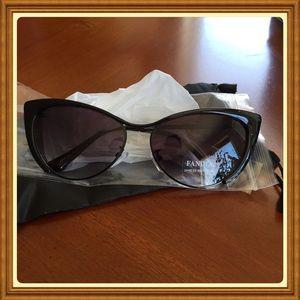 Cat eye sunglasses black in color  lense NWT