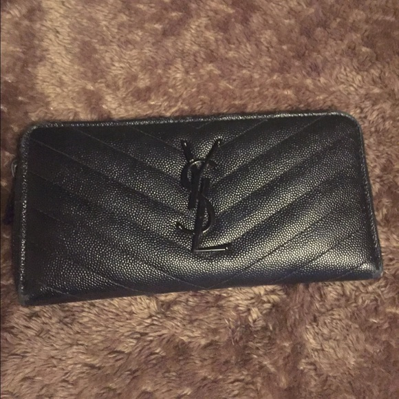 154f8a47f174 MONOGRAM YSL ZIP AROUND WALLET IN BLACK. M 56fe10c9713fdec21a0766bb