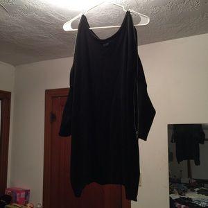 Black zip/unzip top.