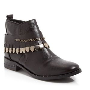 Edgy leather booties w removable strap.