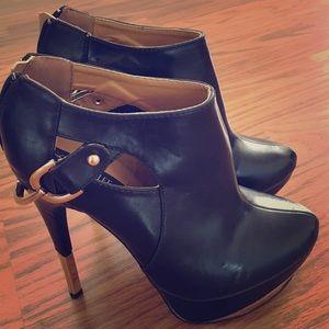 Black booties with spike heel