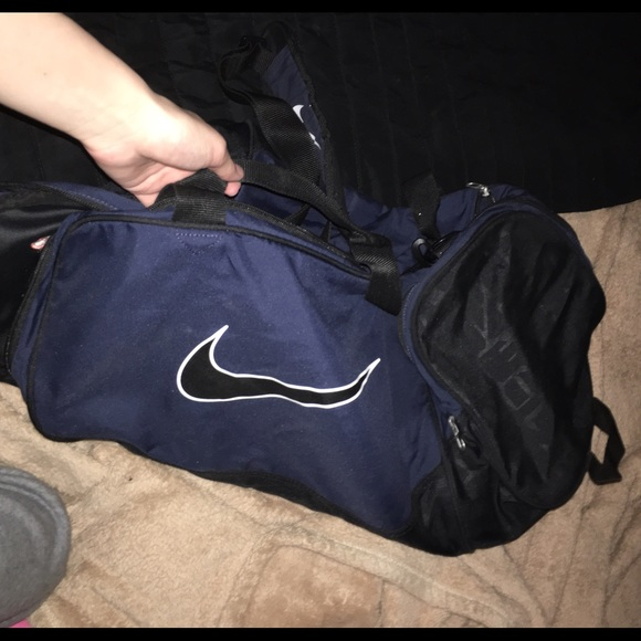 Navy blue nike duffle bag. M 57017bb15a49d0e65200d18b. Other Bags ... bd0aecc940ea6