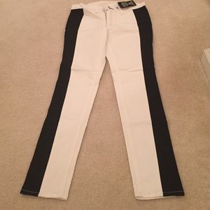 Rag and Bone white skinny jeans with black stripe.