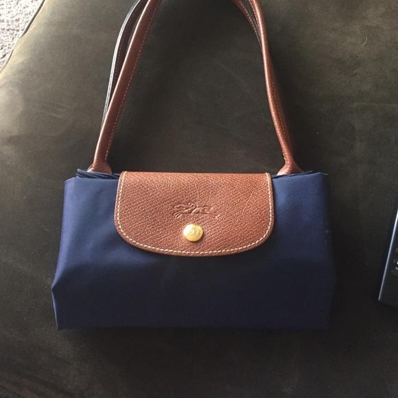 426e0235b91 Longchamp Handbags - Longchamp navy blue small le pliage tote bag