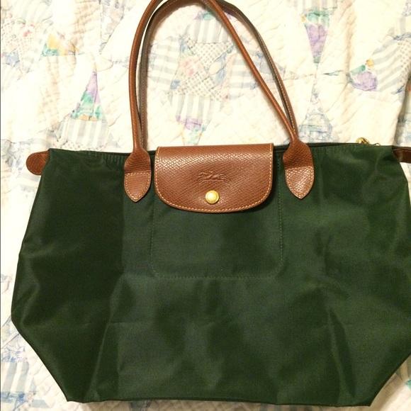 04a97312a47 Longchamp Handbags - Longchamp dark green nylon bag. le pliage