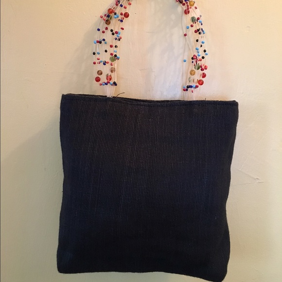 2a6cd881ee Unique Bag with Floating Bead Handle