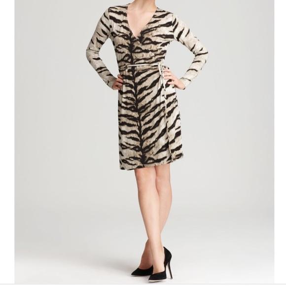5400d33dd5 Michael Kors tiger print wrap dress in a medium. M_570317822599fe4916013592