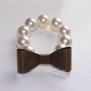Iconic Legend Jewelry - 1 LEFT- Bow faux pearl bracelet