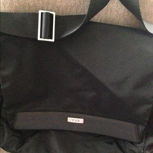 Tumi travel bag with pouch. So versatile.