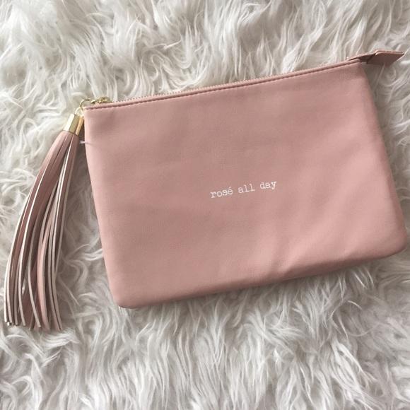 Olivia   Joy - Blush rose pink tassel rose all day Clutch bag from ...