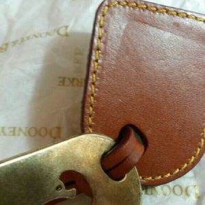 Dooney & Bourke Bags - Sold Dooney Luggage Tag Style Charm.