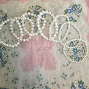 Lot of pearl bracelets and earrings!