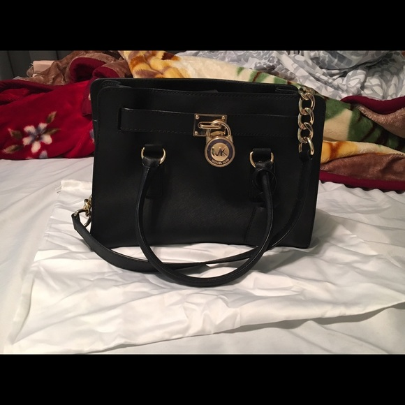 ecc7e345d191 Black HAMILTON SAFFIANO LEATHER MEDIUM SATCHEL. M 570b28e02de512bba30625b7.  Other Bags you may like. Michael kors purses
