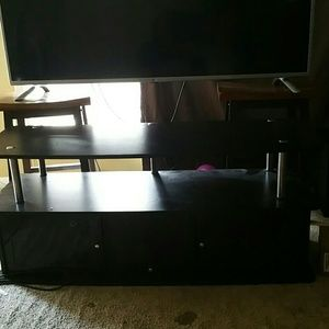 Black tv  stand with cabinet doors for sale