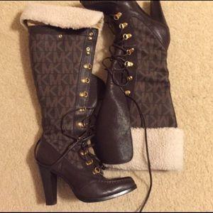 MK monogram authentic lace up boots