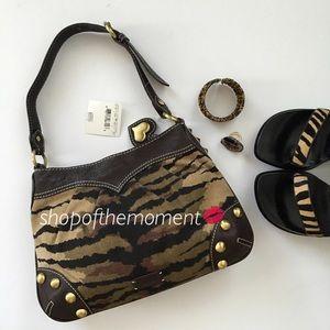 Moschino Handbags - 🐯 Moschino Cheap and Chic Tiger Print Canvas Bag