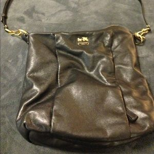 SOLD Black coach bag with gold hardware.