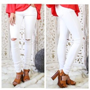 White skinny knee distressed jeans